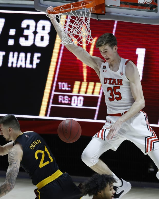 Mar 6, 2021; Salt Lake City, Utah, USA; Utah Utes center Branden Carlson (35) dunks against Arizona State Sun Devils forward Chris Osten (21) in the first half at Jon M. Huntsman Center.