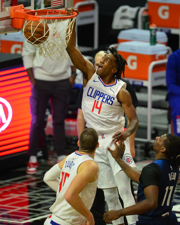 Dec 29, 2020; Los Angeles, California, USA; Los Angeles Clippers guard Terance Mann (14) scores a basket against the Minnesota Timberwolves during the first half at Staples Center. Mandatory Credit: Gary A. Vasquez-USA TODAY Sports
