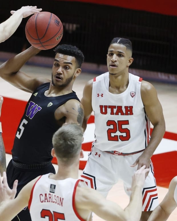 Jamal Bey is surrounded by Utah Utes.