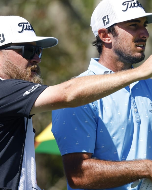 Max Homa, right, confers with caddie Joe Greiner
