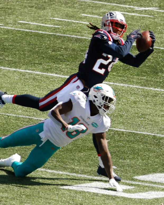 Published Caption: Patriots cornerback Stephon Gilmore intercepts a pass meant for the Dolphins Preston Williams in the first half of Sunday s season-opener. [The Providence Journal / Kris Craig] Original Caption: Foxboro, RI, Sept 13, 2020 - Patriots Stephen Gilmore intercepts a pass meant for Miami's Preston Williams in the first half. Patriots season opener against the Miami Dolphins at Gillette stadium Sunday afternoon. [The Providence Journal / Kris Craig] Pats Defense Ruins The Fitzmagic Show