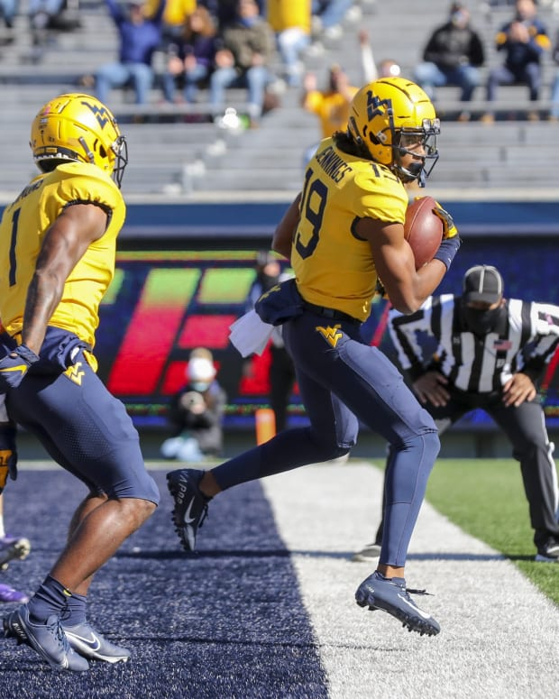 Oct 31, 2020; Morgantown, West Virginia, USA; West Virginia Mountaineers wide receiver Ali Jennings (19) catches a pass for a touchdown during the second quarter against the Kansas State Wildcats at Mountaineer Field at Milan Puskar Stadium.