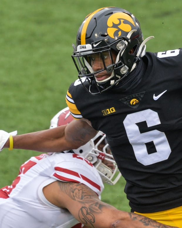 Dec 12, 2020; Iowa City, Iowa, USA; Iowa Hawkeyes wide receiver Ihmir Smith-Marsette (6) runs the ball against the Wisconsin Badgers during the first quarter at Kinnick Stadium. Mandatory Credit: Jeffrey Becker-USA TODAY Sports