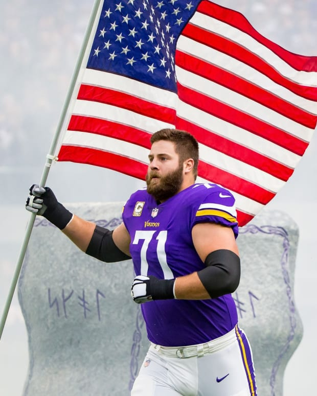 Nov 19, 2017; Minneapolis, MN, USA; Minnesota Vikings offensive lineman Riley Reiff (71) carries the US flag before the game against the Los Angeles Rams at U.S. Bank Stadium. Mandatory Credit: Brad Rempel-USA TODAY Sports