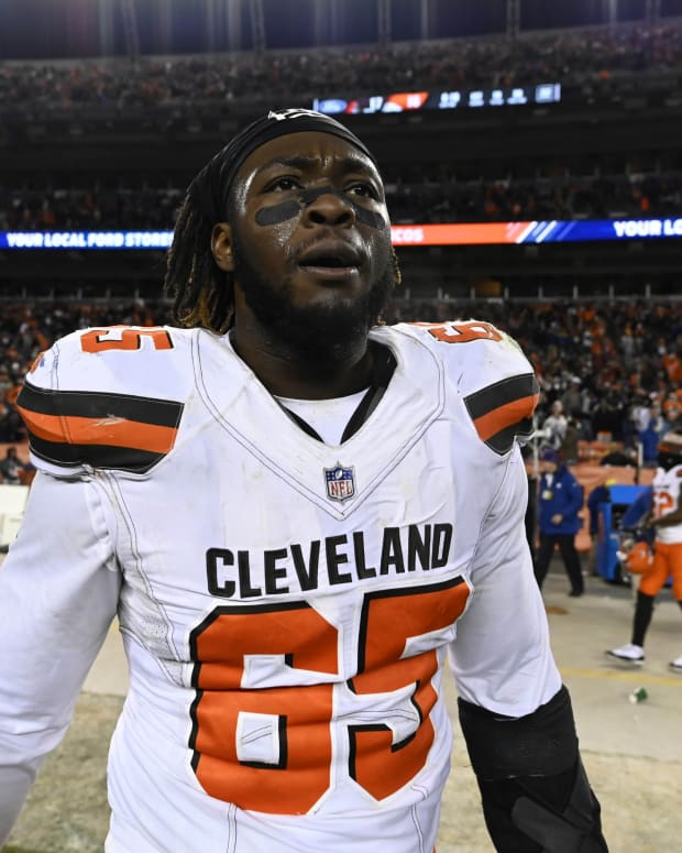 Dec 15, 2018; Denver, CO, USA; Cleveland Browns defensive tackle Larry Ogunjobi (65) reacts following the win over the Denver Broncos at Broncos Stadium at Mile High. Mandatory Credit: Ron Chenoy-USA TODAY Sports