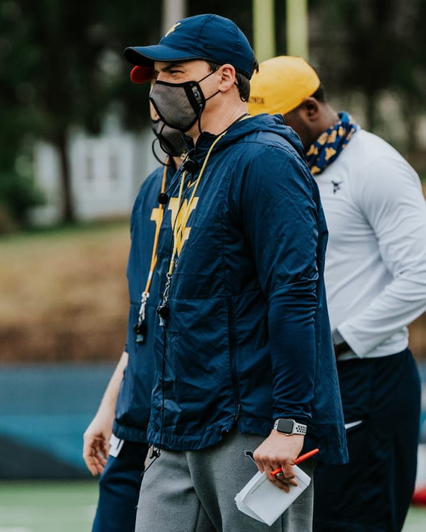 West Virginia head coach Neal Brown looking over the first day of the 2021 spring practice period.