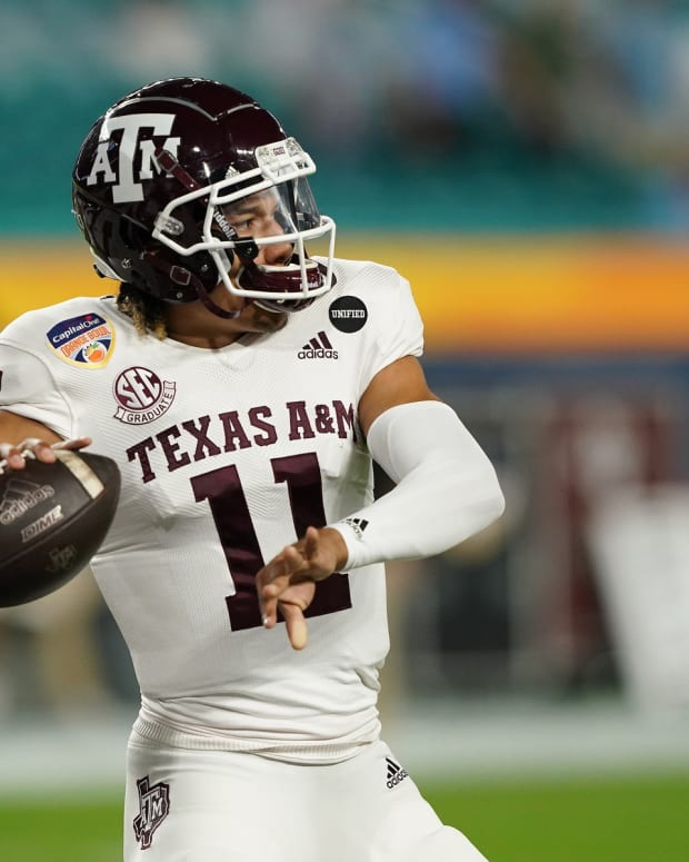 Texas A&M Aggies quarterback Kellen Mond (11) warms up prior to their game against the North Carolina Tar Heels at Hard Rock Stadium.