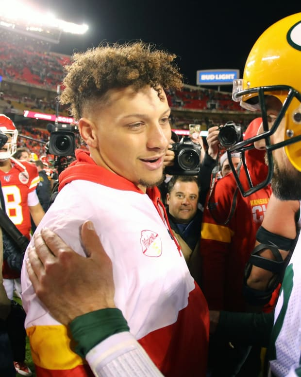 Oct 27, 2019; Kansas City, MO, USA; Green Bay Packers quarterback Aaron Rodgers (12) talks with Kansas City Chiefs quarterback Patrick Mahomes (15) after the game at Arrowhead Stadium. Mandatory Credit: Jay Biggerstaff-USA TODAY Sports