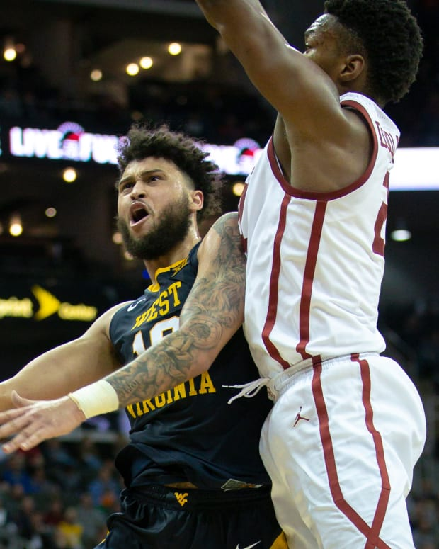 West Virginia Mountaineers guard Jermaine Haley (10) puts up a shot against the Oklahoma Sooners during the second half in the first round of the Big 12 conference tournament at Sprint Center.