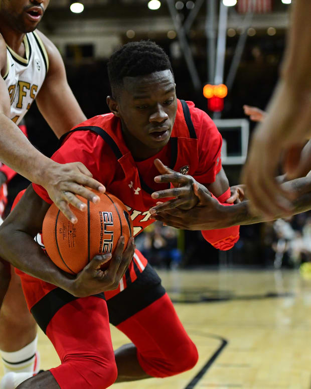 Jan 12, 2020; Boulder, Colorado, USA; Colorado Buffaloes forward Evan Battey (21) and Utah Utes center Lahat Thioune (32) reach for a loose ball in the second half at the CU Events Center.