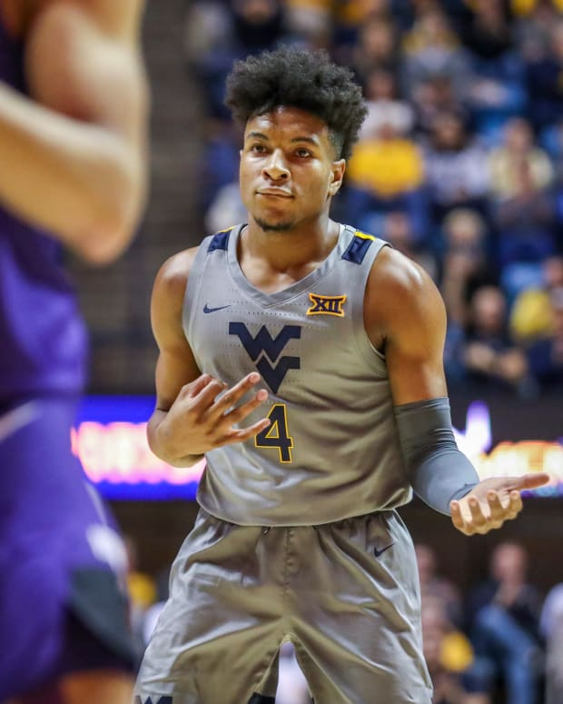 West Virginia Mountaineers guard Miles McBride (4) celebrates after making a three pointer during the second half against the TCU Horned Frogs at WVU Coliseum.