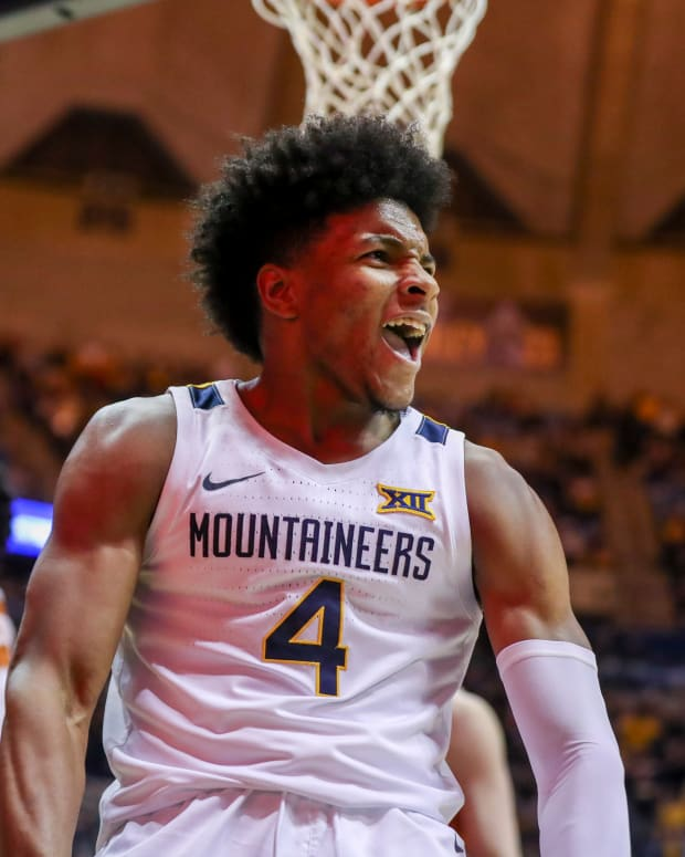 West Virginia Mountaineers guard Miles McBride (4) celebrates after a dunk during the second half against the Texas Longhorns at WVU Coliseum.