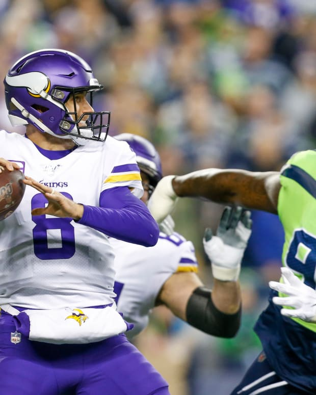 Minnesota Vikings quarterback Kirk Cousins (8) drops back to pass against Seattle Seahawks defensive tackle Jarran Reed (91) during the first quarter at CenturyLink Field.