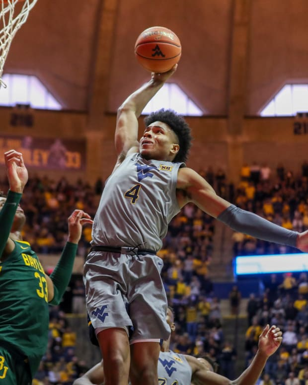 West Virginia Mountaineers guard Miles McBride (4) dunks the ball during the second half against the Baylor Bears at WVU Coliseum.