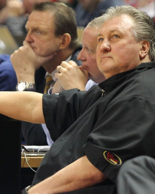 West Virginia Mountaineers head coach Bob Huggins looks on before the game against the Texas Tech Red Raiders at United Supermarkets Arena.