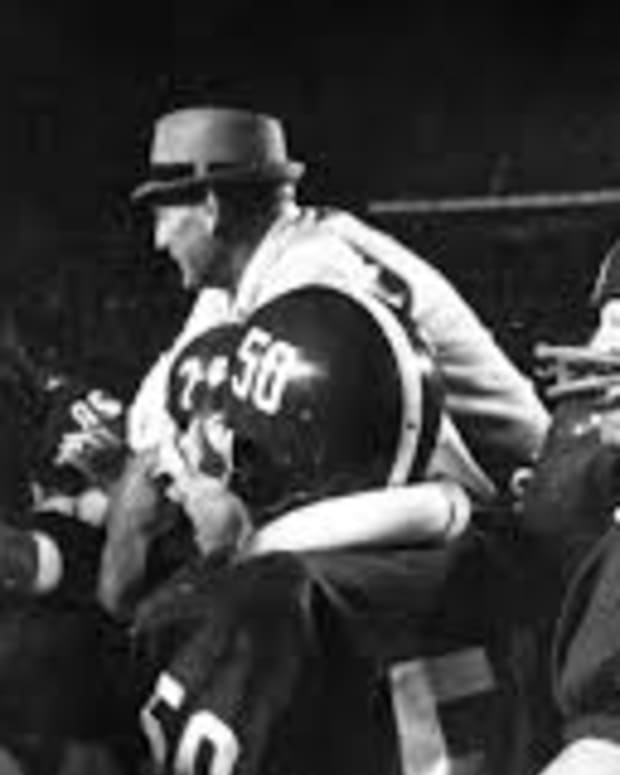Bear Bryant carried off at the 1966 Orange Bowl