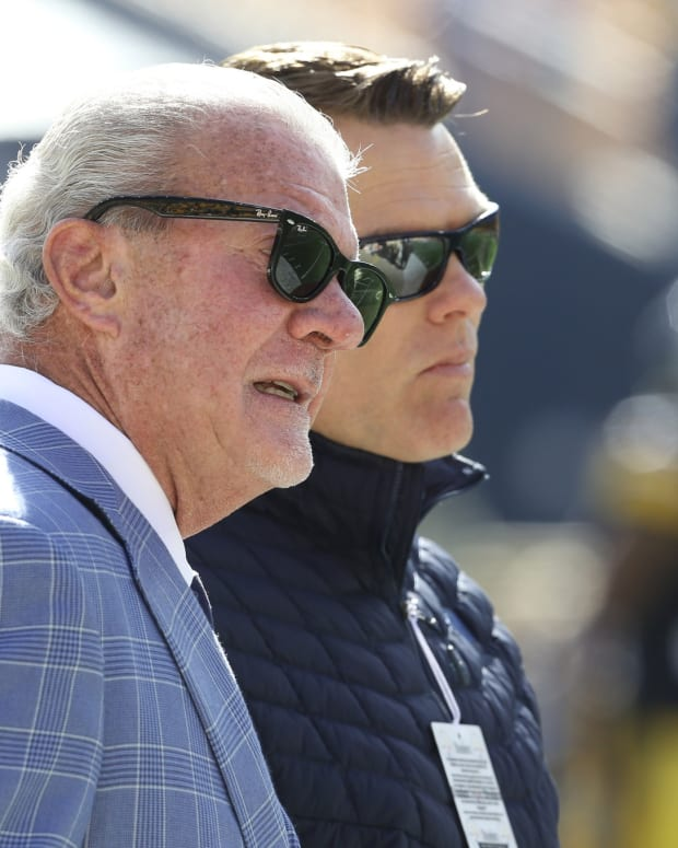 Indianapolis Colts owner Jim Irsay (left) encouraged general manager Chris Ballard (right) to move up in the second round of Friday's NFL draft to select Wisconsin running back Jonathan Taylor with the 41st overall pick.