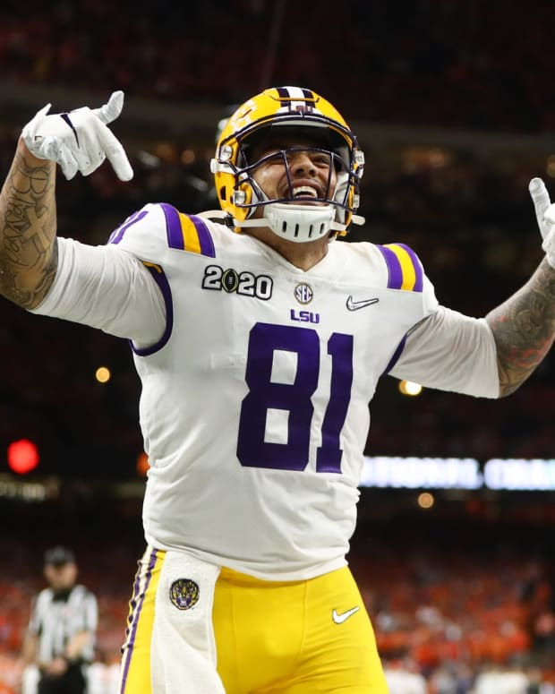 Jan 13, 2020; New Orleans, Louisiana, USA; LSU Tigers tight end Thaddeus Moss (81) celebrates after scoring a touchdown against the Clemson Tigers in the third quarter in the College Football Playoff national championship game at Mercedes-Benz Superdome. Mandatory Credit: Mark J. Rebilas-USA TODAY Sports