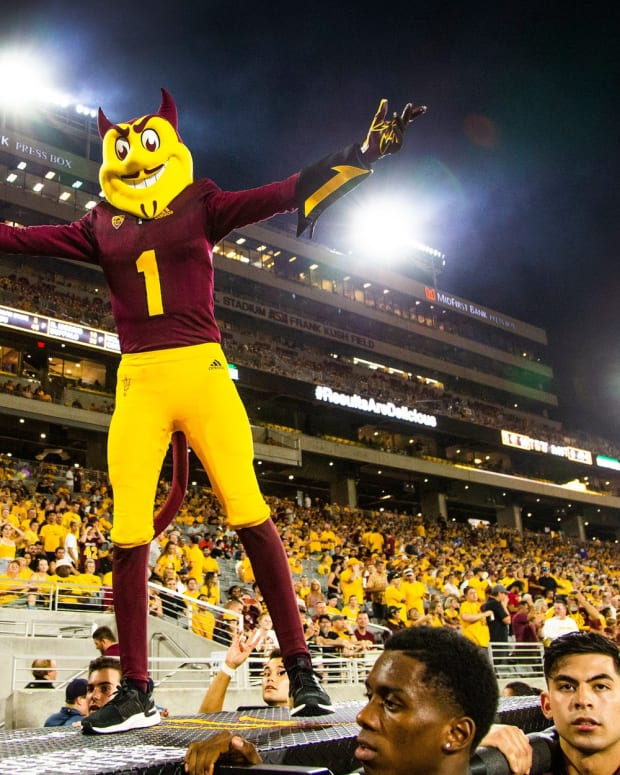 Sparky, the Arizona State University mascot, encourages the student section during second quarter action against Kent State University at Sun Devil Stadium, Thursday, August 29,
