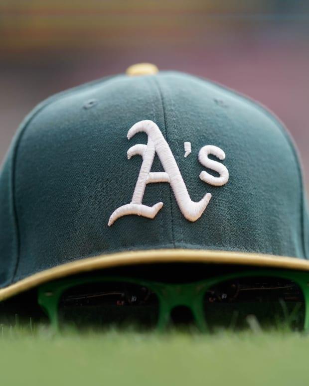 A's hat, Coliseum grass, 2019