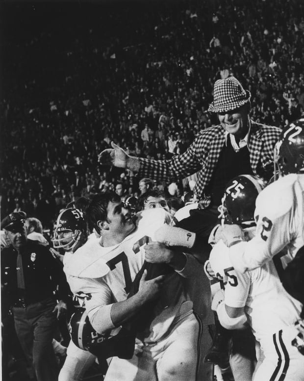 """Paul W. """"Bear Bryant is carried off the field"""