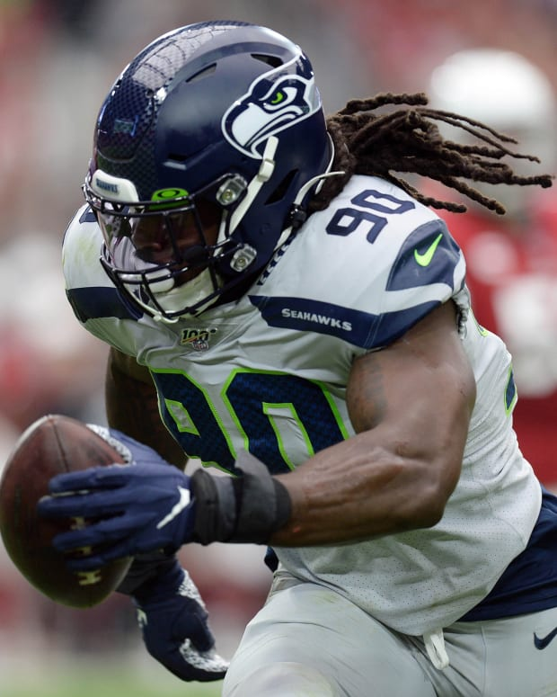 Sep 29, 2019; Glendale, AZ, USA; Seattle Seahawks outside linebacker Jadeveon Clowney (90) returns an interception for a touchdown against the Arizona Cardinals during the first half at State Farm Stadium. Mandatory Credit: Joe Camporeale-USA TODAY Sports