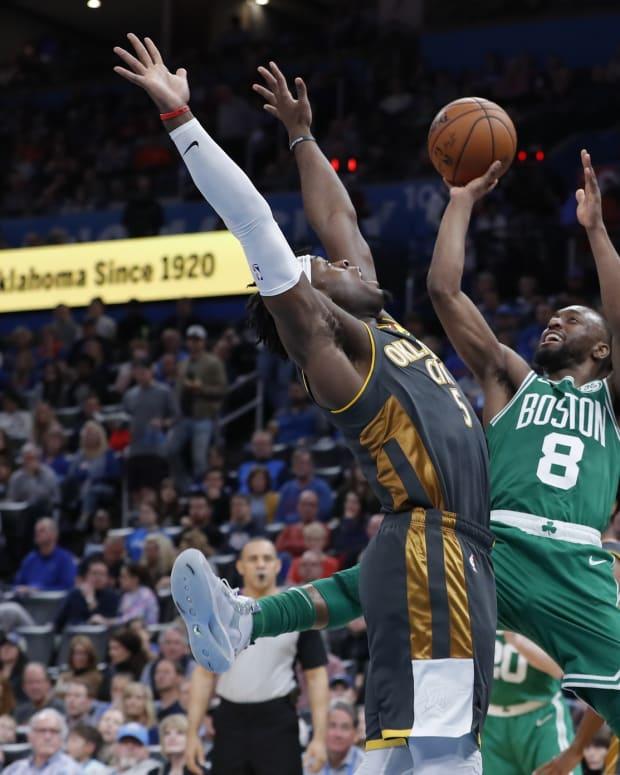 Boston Celtics guard Kemba Walker (8) shoots as Oklahoma City Thunder guard Luguentz Dort (5) defends during the second half at Chesapeake Energy Arena. Boston won 112-111.