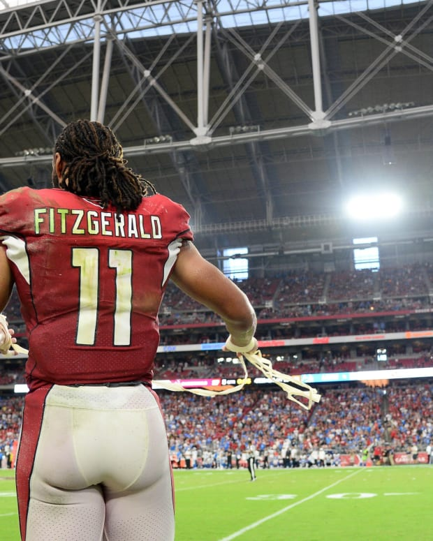 Arizona Cardinals wide receiver Larry Fitzgerald (11) reacts during overtime against the Detroit Lions at State Farm Stadium.