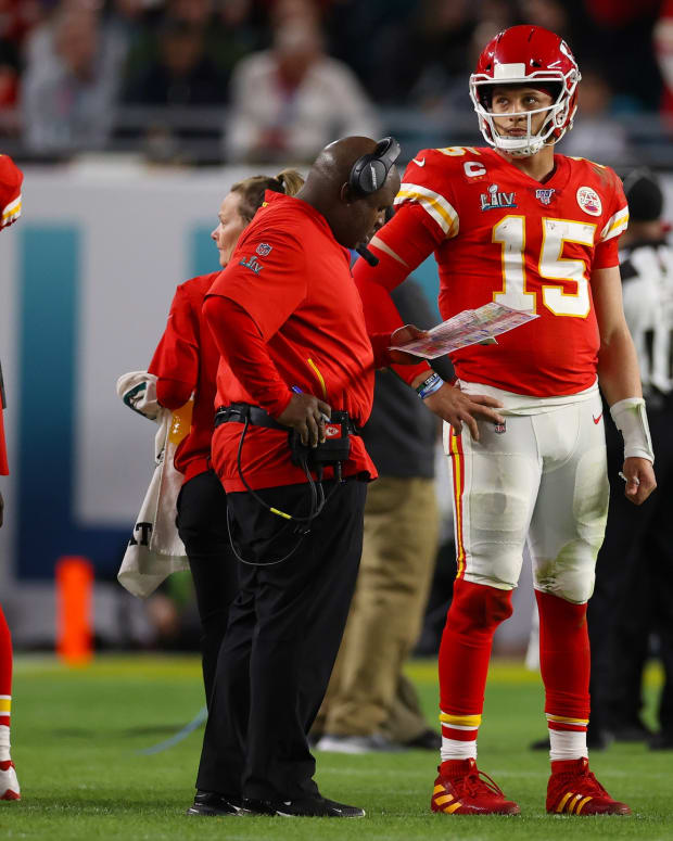 Feb 2, 2020; Miami Gardens, Florida, USA; Kansas City Chiefs quarterback Patrick Mahomes (15) with offensive coordinator Eric Bieniemy during a timeout from the game against the San Francisco 49ers in Super Bowl LIV at Hard Rock Stadium. Mandatory Credit: Matthew Emmons-USA TODAY Sports