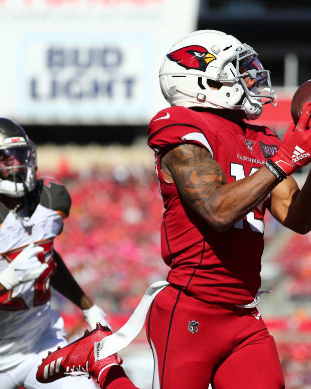 Arizona Cardinals wide receiver Christian Kirk (13) catches the ball over Tampa Bay Buccaneers cornerback Vernon III Hargreaves (28) for a touchdown during the second quarter at Raymond James Stadium.