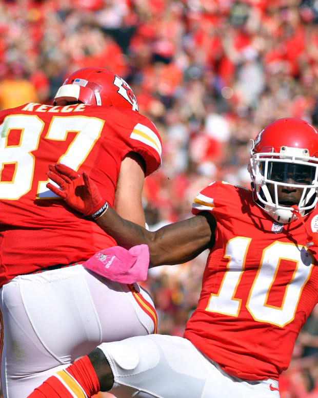 Oct 23, 2016; Kansas City, MO, USA; Kansas City Chiefs wide receiver Tyreek Hill (10) and tight end Travis Kelce (87) celebrate after Hill's touchdown during the first half against the New Orleans Saints at Arrowhead Stadium. Mandatory Credit: Denny Medley-USA TODAY Sports