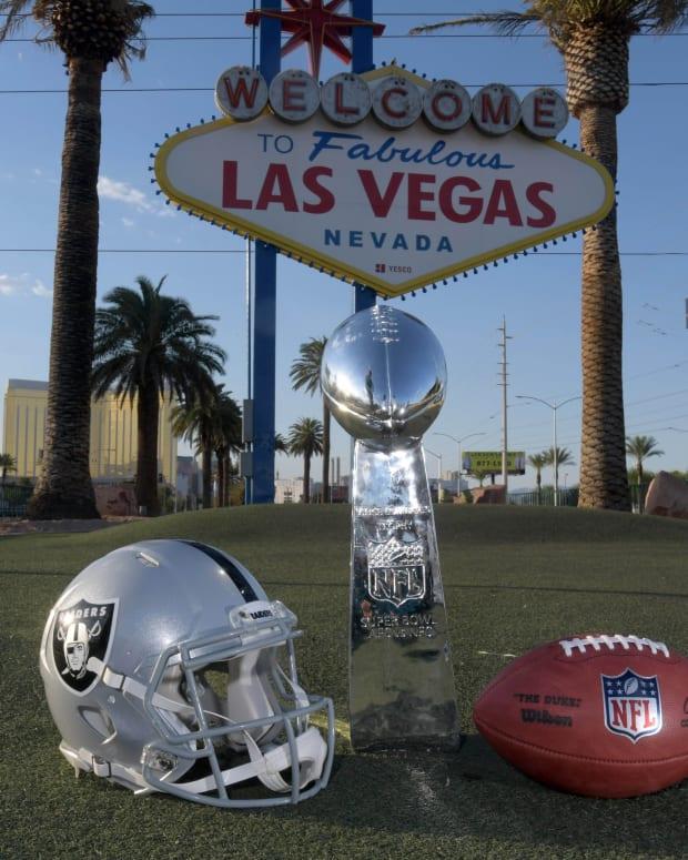 NFL Ball Lombardi Raiders Helmet Sign