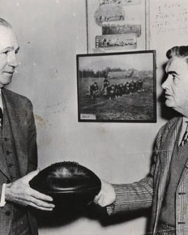 Wallace Wade hands a ball to his successor, Frank Thomas