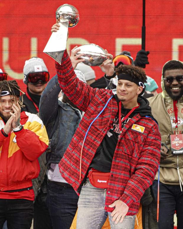 Feb 5, 2020; Kansas City, Missouri, USA; Kansas City Chiefs quarterback Patrick Mahomes (15) hoists the Lombardi Trophy during the Super Bowl LIV championship rally in Kansas City, Missouri. Mandatory Credit: Jay Biggerstaff-USA TODAY Sports