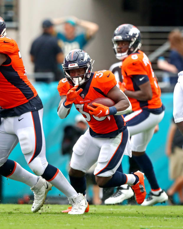 Denver Broncos running back Javonte Williams (33) runs the ball during the second half against the Jacksonville Jaguars at TIAA Bank Field.
