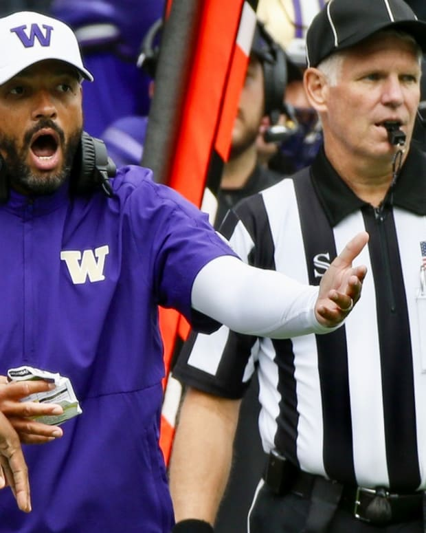 Washington coach Jimmy Lake pleads his case to the officials
