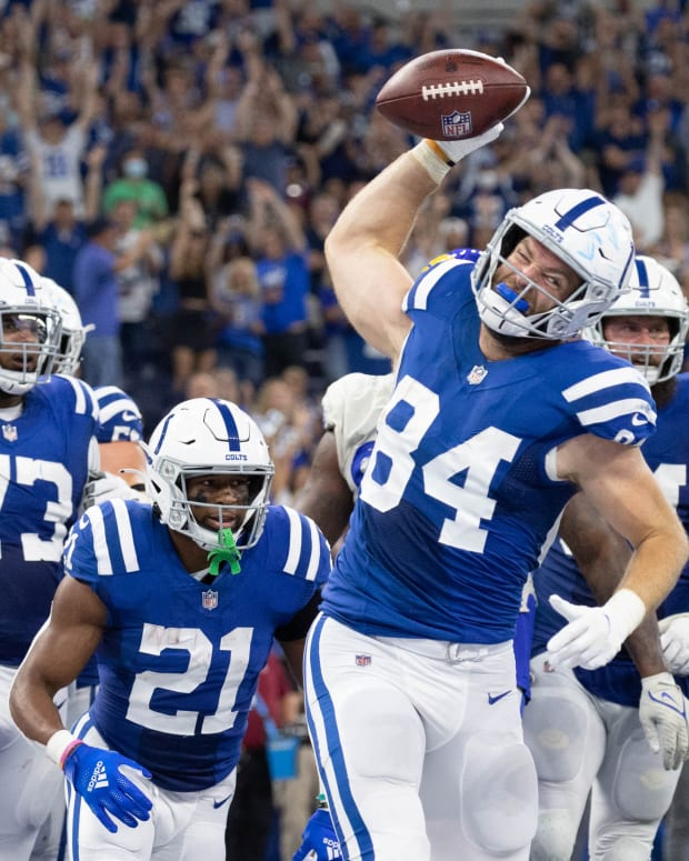 Sep 19, 2021; Indianapolis, Indiana, USA; Indianapolis Colts tight end Jack Doyle (84) spikes the ball after his two point conversion in the second half against the Los Angeles Rams of the game at Lucas Oil Stadium.