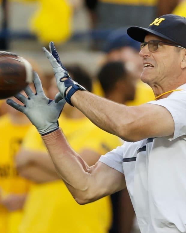 Jim Harbaugh catching