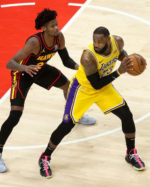 Atlanta Hawks guard Cam Reddish (22) defends Los Angeles Lakers forward LeBron James (23) in the fourth quarter at State Farm Arena.