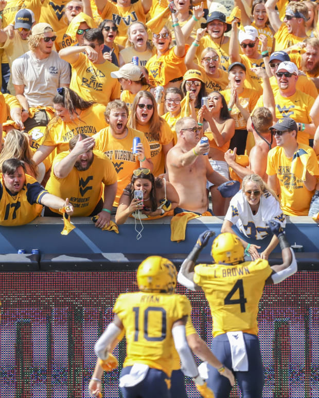 Sep 18, 2021; Morgantown, West Virginia, USA; West Virginia Mountaineers students celebrate after a touchdown from West Virginia Mountaineers running back Leddie Brown (4) during the first quarter against the Virginia Tech Hokies at Mountaineer Field at Milan Puskar Stadium.
