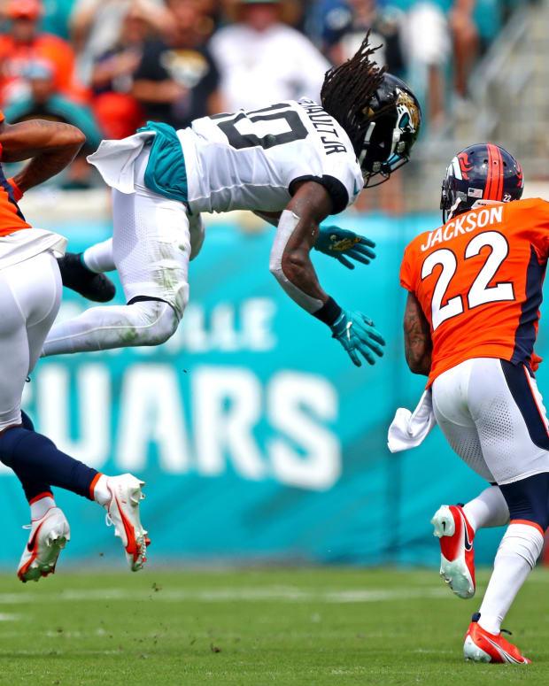 Denver Broncos cornerback Pat Surtain II (2) and strong safety Kareem Jackson (22) break up a pass intended for Jacksonville Jaguars wide receiver Laviska Shenault Jr. (10) during the second quarter at TIAA Bank Field.