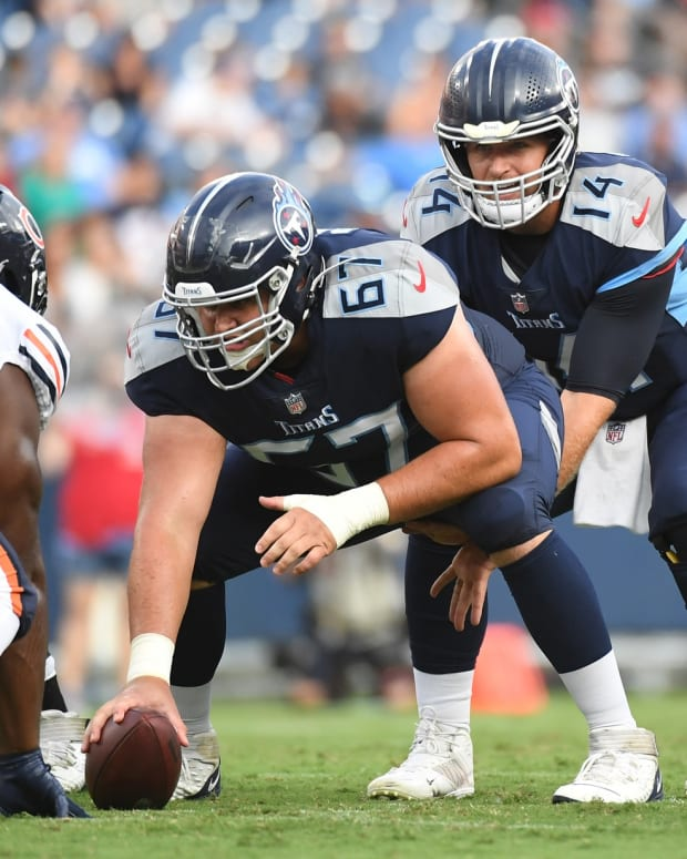 Aug 28, 2021; Nashville, TN, USA; Tennessee Titans quarterback Matt Barkley (14) takes the snap from Tennessee Titans center Cole Banwart (67) during the first half against the Chicago Bears at Nissan Stadium.