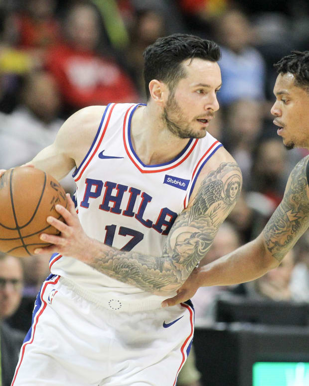 Philadelphia 76ers guard JJ Redick (17) is defended by Atlanta Hawks guard Damion Lee (8) in the fourth quarter at Philips Arena.