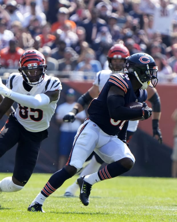 Sep 19, 2021; Chicago, Illinois, USA; Chicago Bears strong safety Tashaun Gipson (38) recovers a fumble against the Cincinnati Bengals during the second half at Soldier Field. Mandatory Credit: Mike Dinovo-USA TODAY Sports