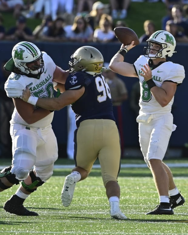 Sep 4, 2021; Annapolis, Maryland, USA; Marshall Thundering Herd quarterback Grant Wells (8) throws as offensive lineman Will Ulmer (50) blocks Navy Midshipmen defensive lineman Pryson Greer (96) durning the second half at Navy-Marine Corps Memorial Stadium. Mandatory Credit: Tommy Gilligan-USA TODAY Sports