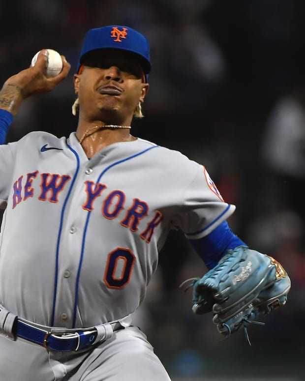 Sep 21, 2021; Boston, Massachusetts, USA; New York Mets starting pitcher Marcus Stroman (0) throws against the Boston Red Sox during the first inning at Fenway Park.