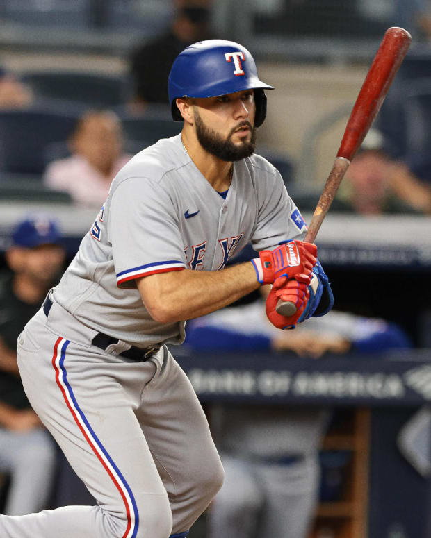 Sep 20, 2021; Bronx, New York, USA; Texas Rangers third baseman Isiah Kiner-Falefa (9) hits an RBI double against the New York Yankees during the fifth inning at Yankee Stadium. Mandatory Credit: Vincent Carchietta-USA TODAY Sports