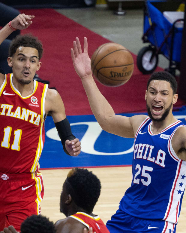 Atlanta Hawks guard Trae Young (11) passes the ball past Philadelphia 76ers guard Ben Simmons (25) during the third quarter in game five of the second round of the 2021 NBA Playoffs at Wells Fargo Center.