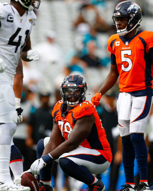 Denver Broncos center Lloyd Cushenberry (79) looks to hike the ball to Denver Broncos quarterback Teddy Bridgewater (5) in the fourth quarter against the Jacksonville Jaguars at TIAA Bank Field.