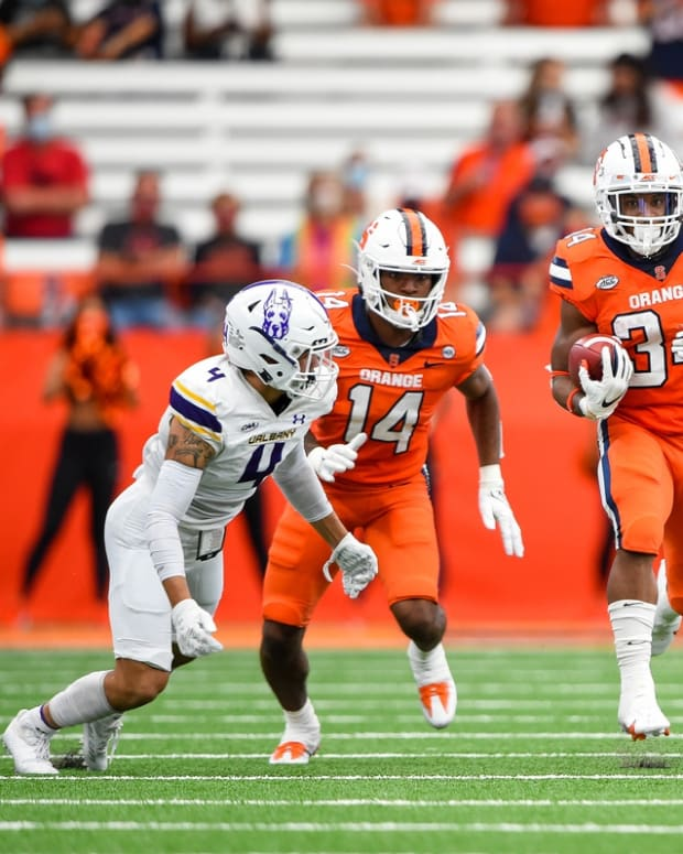 Sep 18, 2021; Syracuse, New York, USA; Syracuse Orange running back Sean Tucker (34) runs with the ball against the Albany Great Danes during the first half at the Carrier Dome. Mandatory Credit: Rich Barnes-USA TODAY Sports